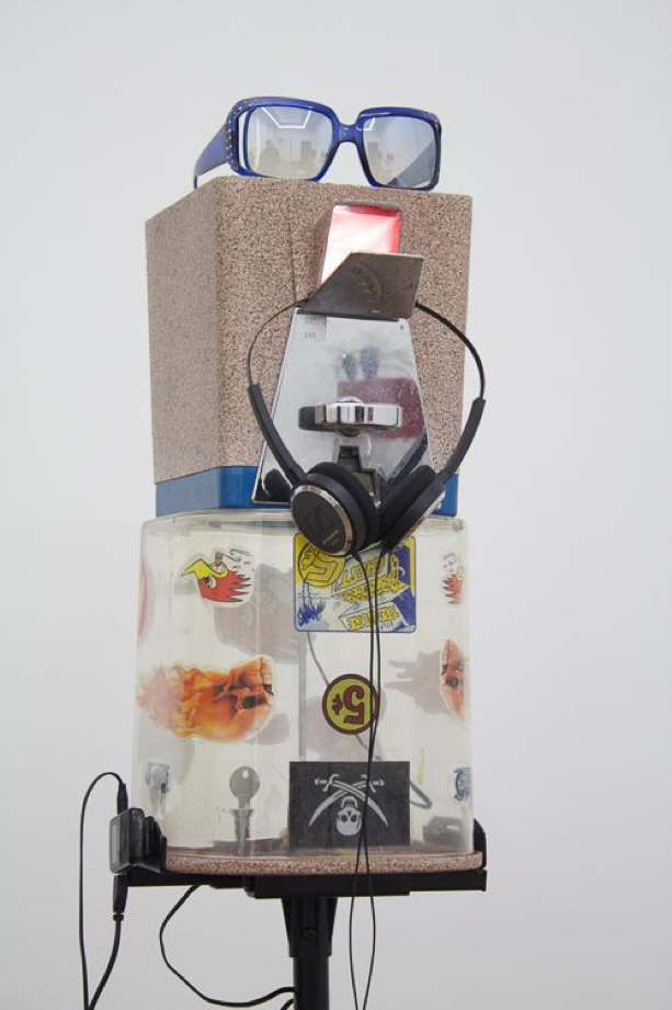Head Stands/Confetti, 2016 Candy dispenser, looped audio, sunglasses, mp3 player, headphones, LED light, speaker stand 8 x 10 x 60 inches, Photo Credit: 247365